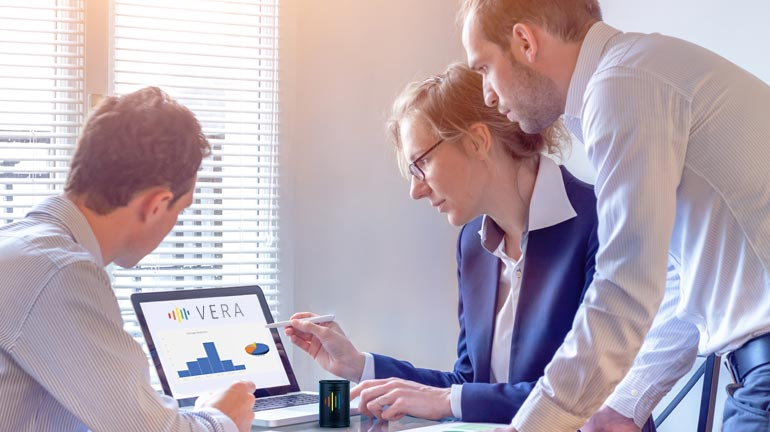 Financial industry executives analyzing reports extracted by the voice assistant