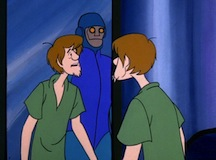 Shaggy in a hall of mirrors with a robot.
