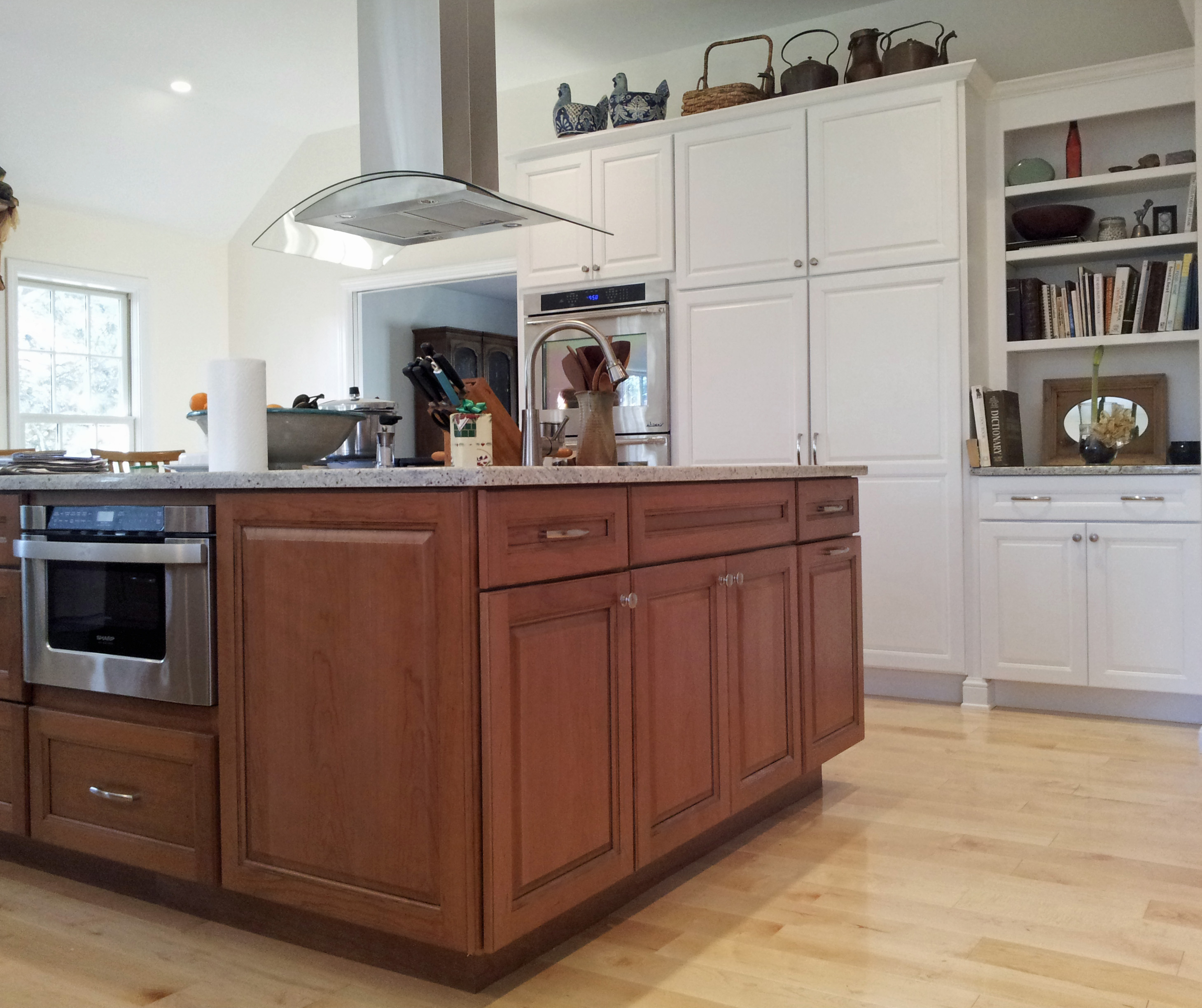 Beautiful stained full overlay Island cabinetry mixed with painted perimeter cabinetry