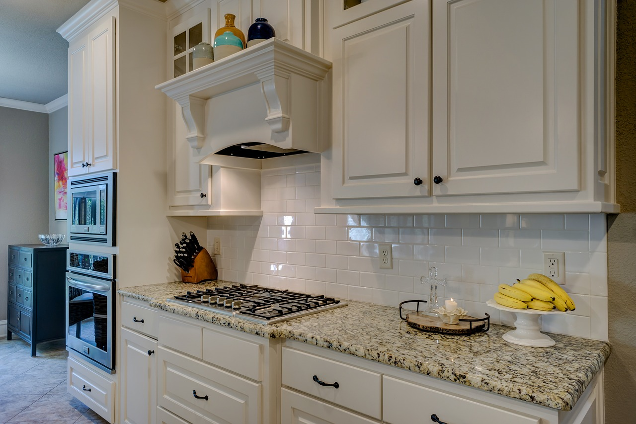 custom wood vent hood with molding is an elegant feature