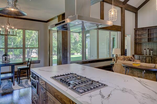 mission style kitchen with rustic lodge style lighting and modern appliances