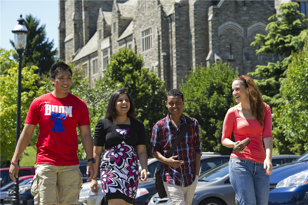 International students walking on campus.