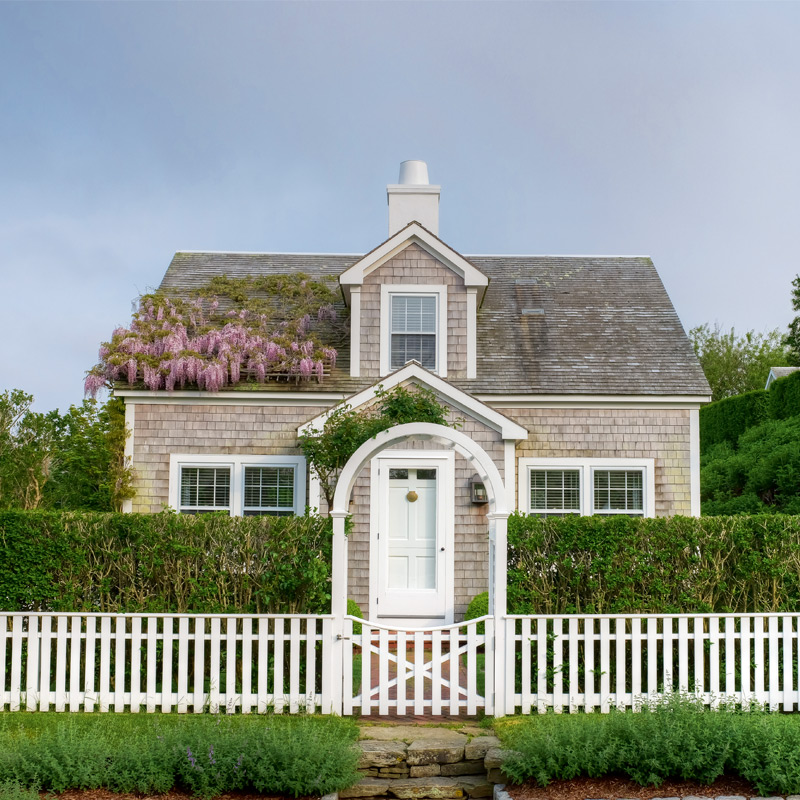Cobble Hill House, built in classic Nantucket gray cedar shingle. Photography by Greg Hinson