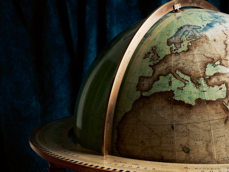There's no room for error, however small, when it comes to crafting a geographically accurate globe. Photograph: Ian Nolan. Stylist: Sophie Martell. Fabric: Molano velvet in teal, Designers Guild
