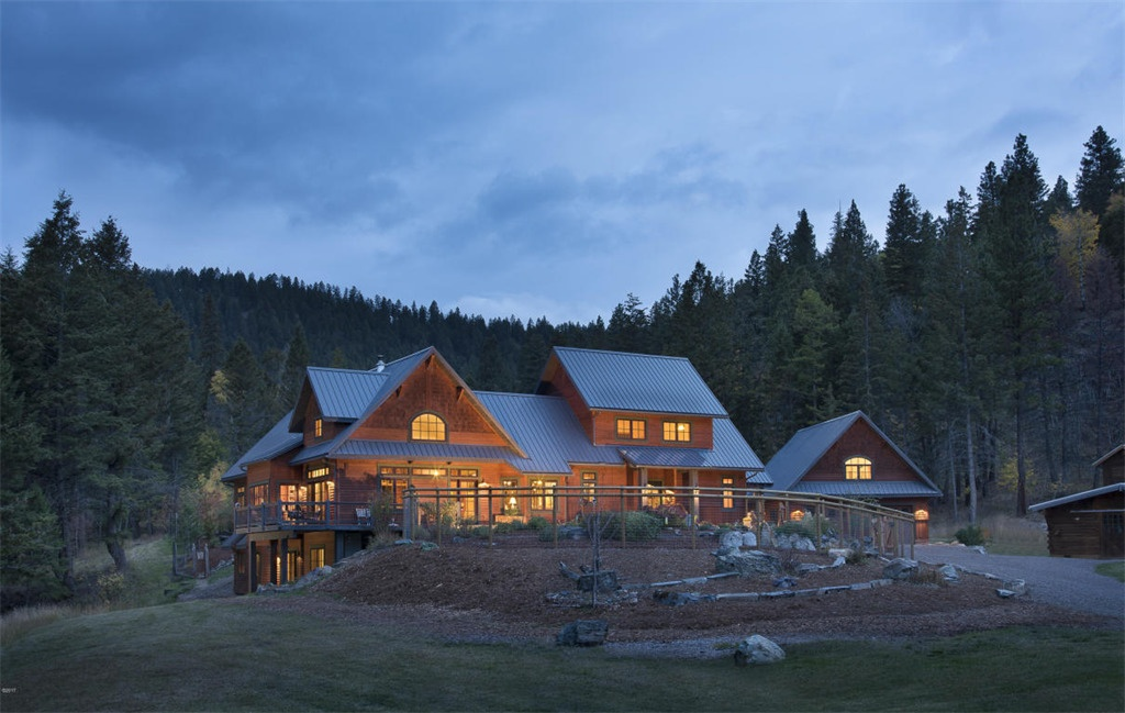 The Sanctuary is a spectacular mountaintop retreat just west of Kalispell. Situated on a grassy bench with a dramatic cliff backdrop and valley views, the 5,569-square-foot main home is finished with luxurious detail, and is one of the few LEED-Certified residences in Northwest Montana, providing unparalleled energy efficiency.
