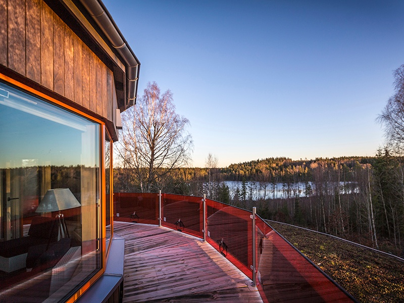 The Villa Circuitus' veranda has a balustrade with integrated solar panels, which make the home self-sufficient for most of the year. The round shape is designed to expose the smallest surface possible to the outdoor air in order to reduce heat loss. Photograph: Anders Borgôn. Banner image: Green Orchard house. Photograph: Paul Archer
