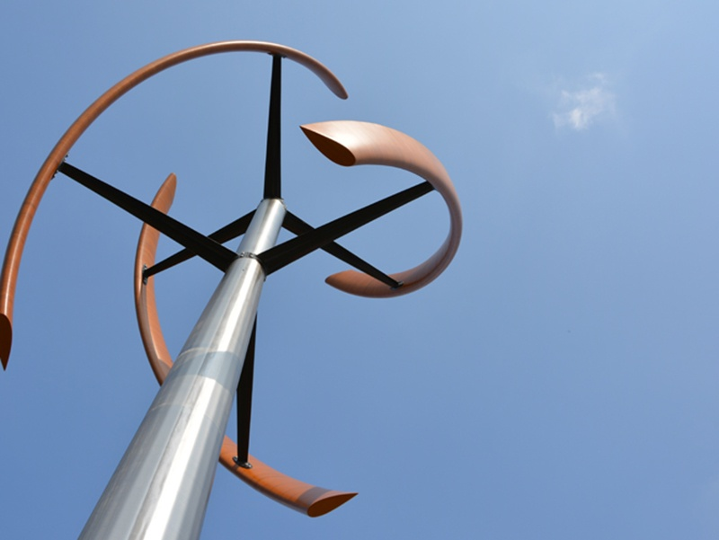 The Enessere Hercules wind generator, designed by Terry Glenn Phipps, is proof that wind turbines can match design to function. The curved wooden blades of the structure make it look more like a sculpture than a practical wind turbine. Photograph: Veronica Tessaro