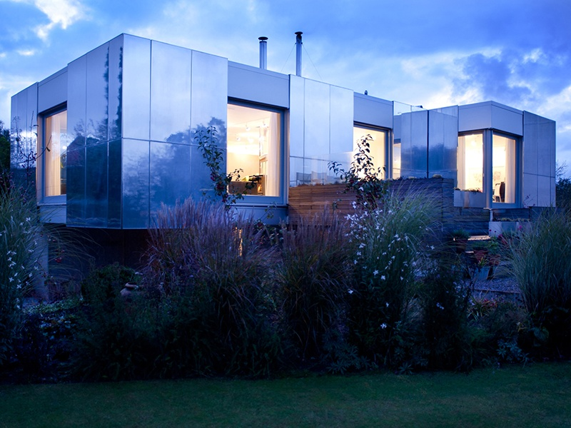 Green Orchard, the zero-carbon home designed by Paul Archer, features a highly insulated exterior clad in full-height panels that allow the inhabitants to control how much light and solar heat permeate the house. Photograph: Helen Fickling