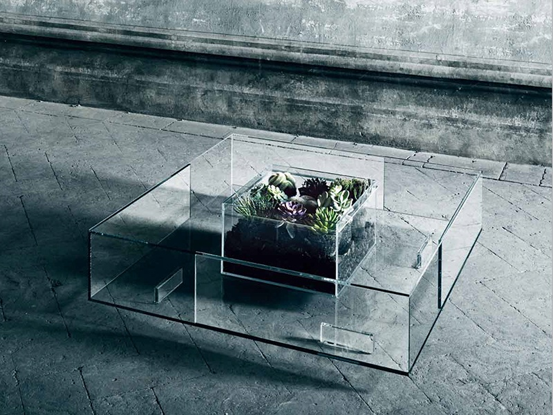 The Seasons table designed by Jean-Marie Massaud features a basin in the center that can be used in various ways: as a vase, aquarium, or a bioethanol-fueled fire. Photograph: Glas Italia