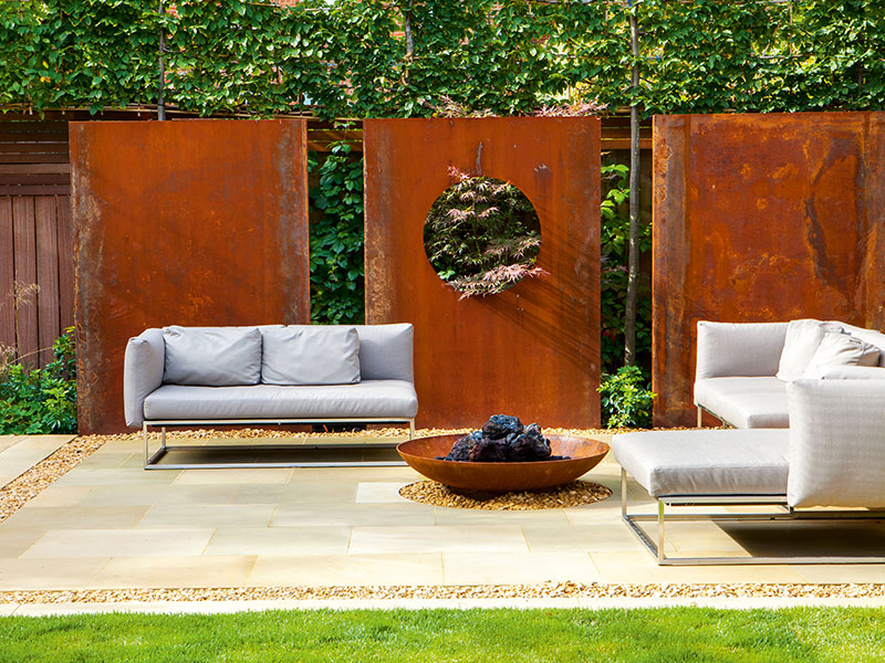 rusted metal is a popular accent in our green spaces often as freestanding sculpture