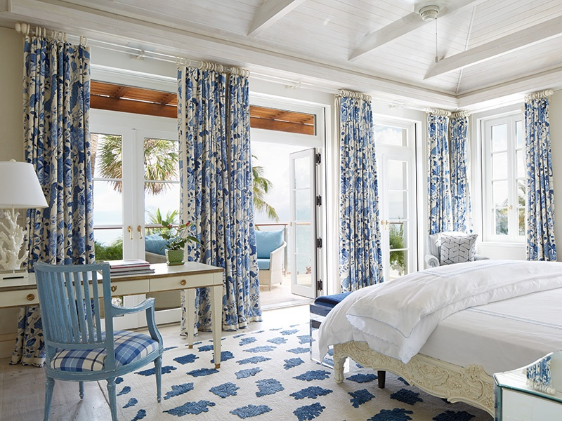 Indoor spaces are decorated in varying hues of blue, with the master suite featuring a pale shade with richly patterned drapes and rugs. Photograph: Laura Moss
