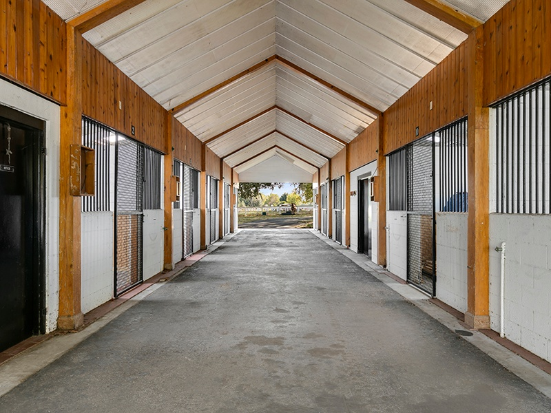 Ideal for equestrian professionals, the Shirley Shores estate comprises a race track, three barns with 52 stalls, multiple paddocks and pastures, and a guest house for trainers, staff, or guests. Photograph: Regal Real Estate Professionals