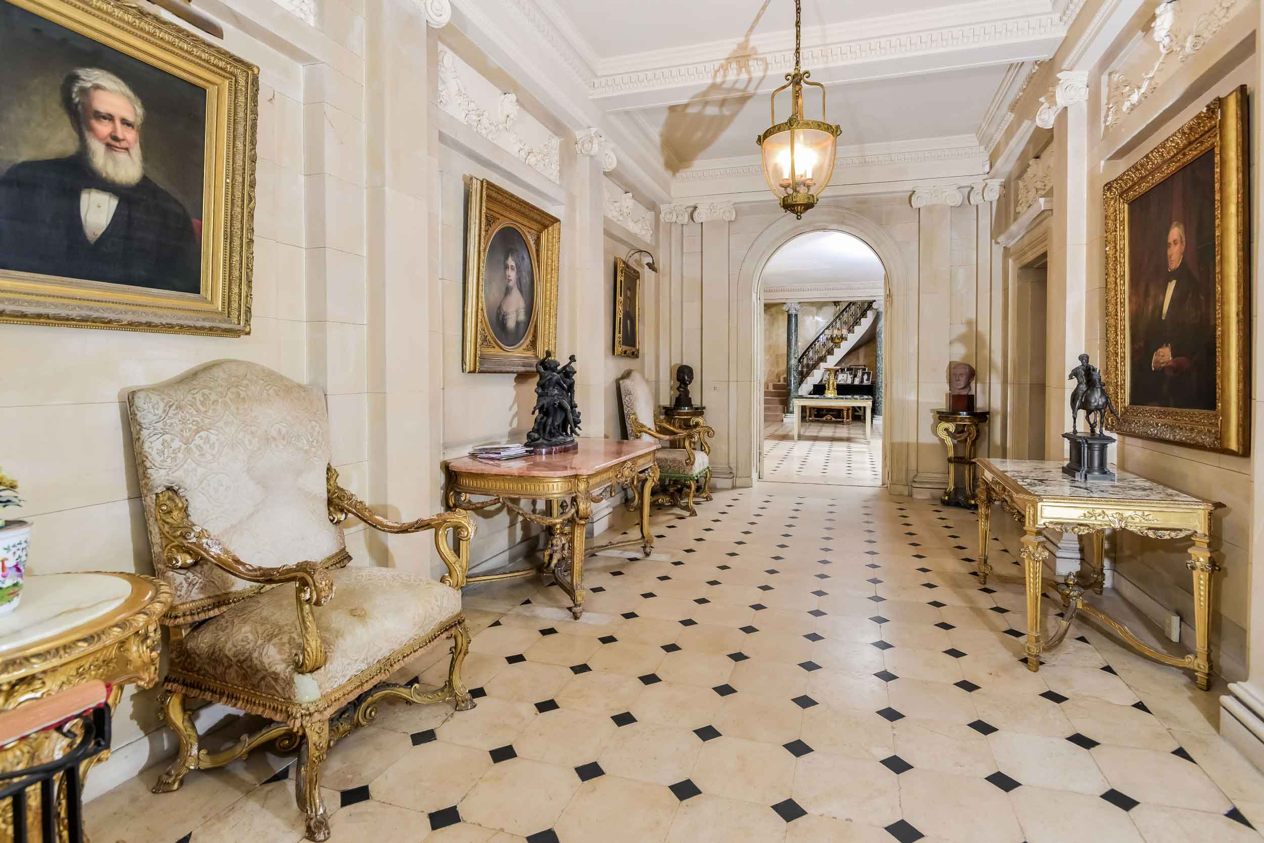 The Harold Brown Villa has an elegant exterior crafted from stone, with a formal interior executed in classical French Empire style. The sumptuous finishes include marble floors and Ionic columns and intricate wood paneling and millwork.
