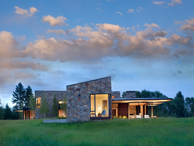 Gray stone walls and the metal-clad roof blend seamlessly with the surrounding area. Photograph: Gibeon Photography