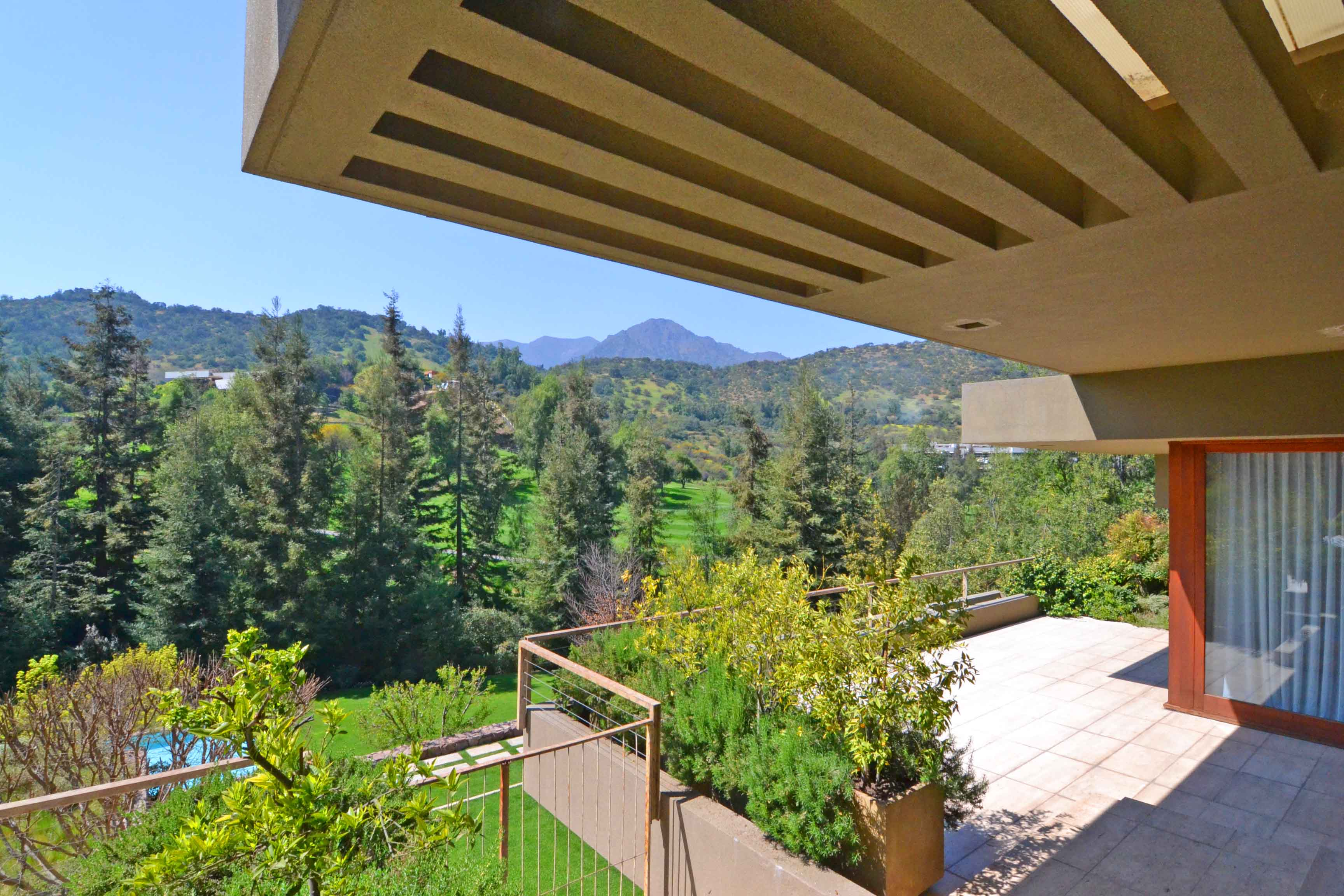 This contemporary home on the Valle Escondido golf course, near the Chilean capital of Santiago, boasts a breathtaking panorama of the greens and the Andes Mountains.