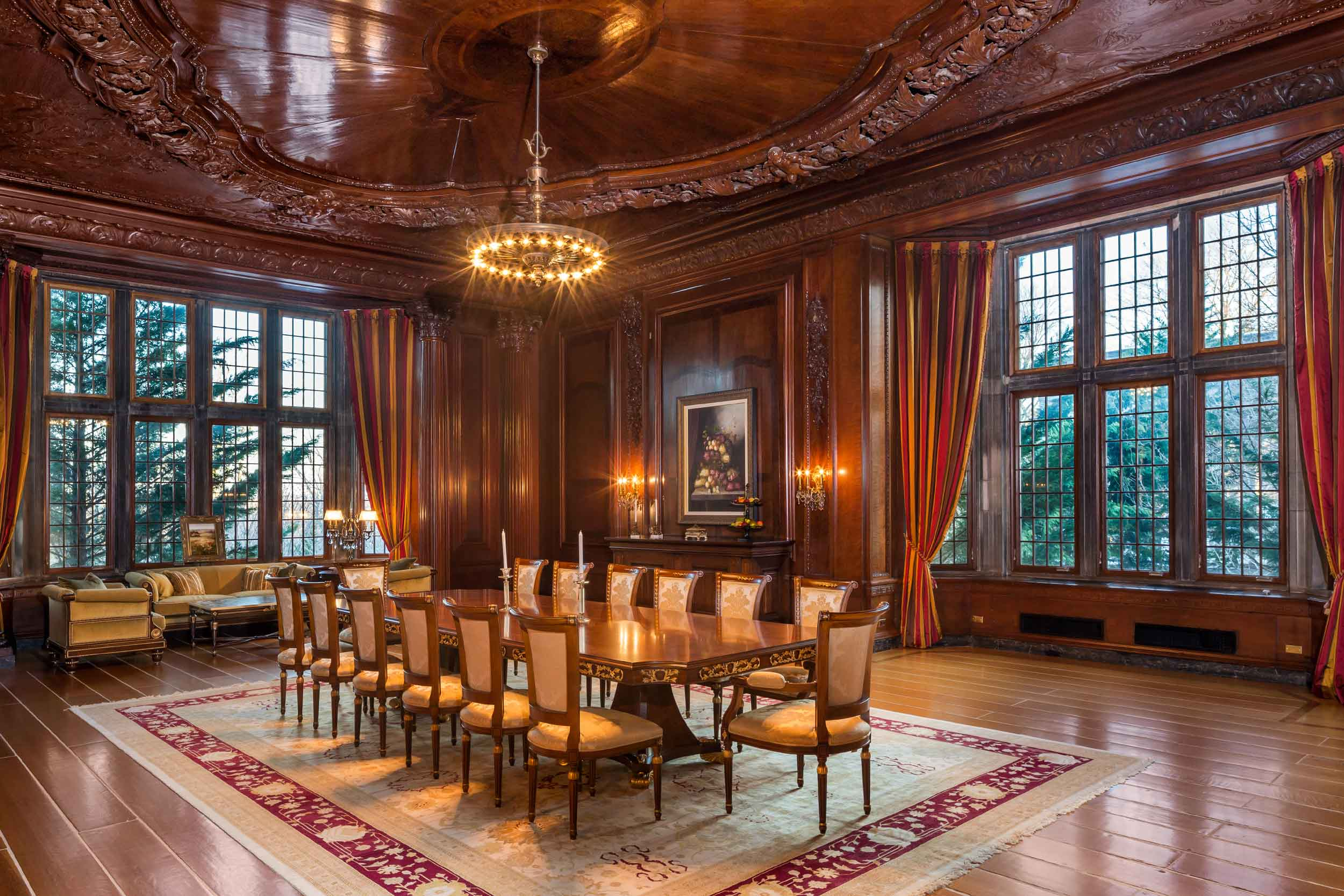 The Jacobean-style mansion was painstakingly restored over a seven-year period by an international team of artisans, artists, and designers. In the dining room, an exquisite coffered ceiling, a monumental limestone fireplace, and beautiful mullioned windows are examples of Darlington's Gilded Age splendor.