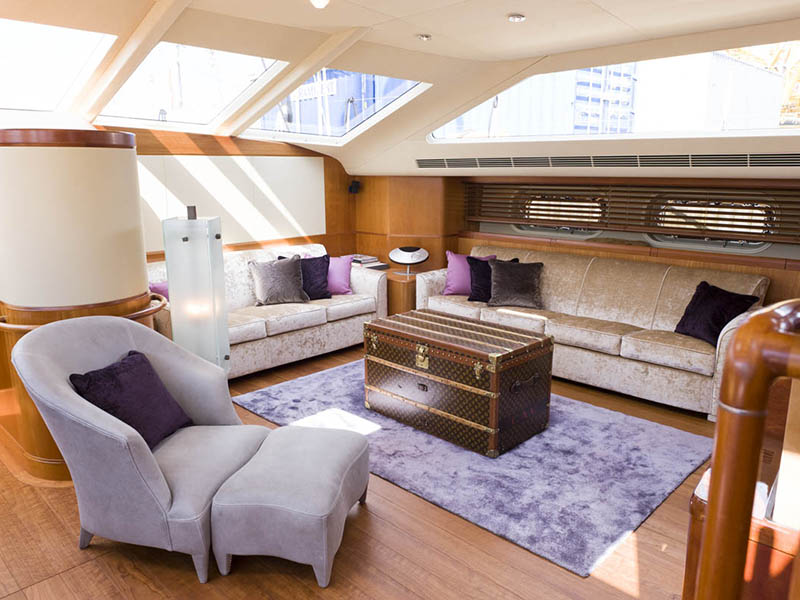The 152-foot sloop <i>Pink Gin</i> was first styled by Design Unlimited in 2006, and featured freestanding custom parchment pieces. A 2011 refit included new furnishings, fabrics, and blinds.