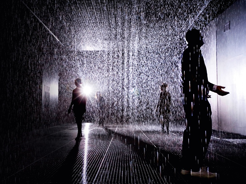 "Alongside a mixed media list that includes water, injection-molded tiles, solenoid valves, and pressure regulators, Random International's <i>Rain Room</i>, which opened at London's Barbican Centre in October 2012, made use of ""custom software"" and ""3D tracking cameras."" Photograph: Rain Room Installation image © Felix Clay, Rain Room – Random International 2012, Courtesy of Barbican Art Gallery. Banner image: A video still from Pipilotti Rist's <i>Mercy Garden Retour Skin</i> (2014) audio video installation. Banner photograph: © Pipilotti Rist, Courtesy the Artist, Hauser &amp; Wirth, and Luhring Augustine; Mark Metcalfe/Stringer/Getty Images"