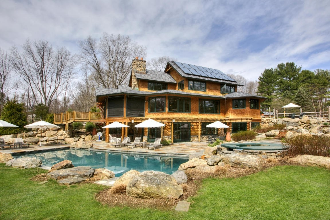 Custom designed and conscientiously built, this remarkable LEED Platinum-certified home was purposefully integrated into its 4.6-acre environment, a glorious natural landscape replete with native trees, water features, and stone.