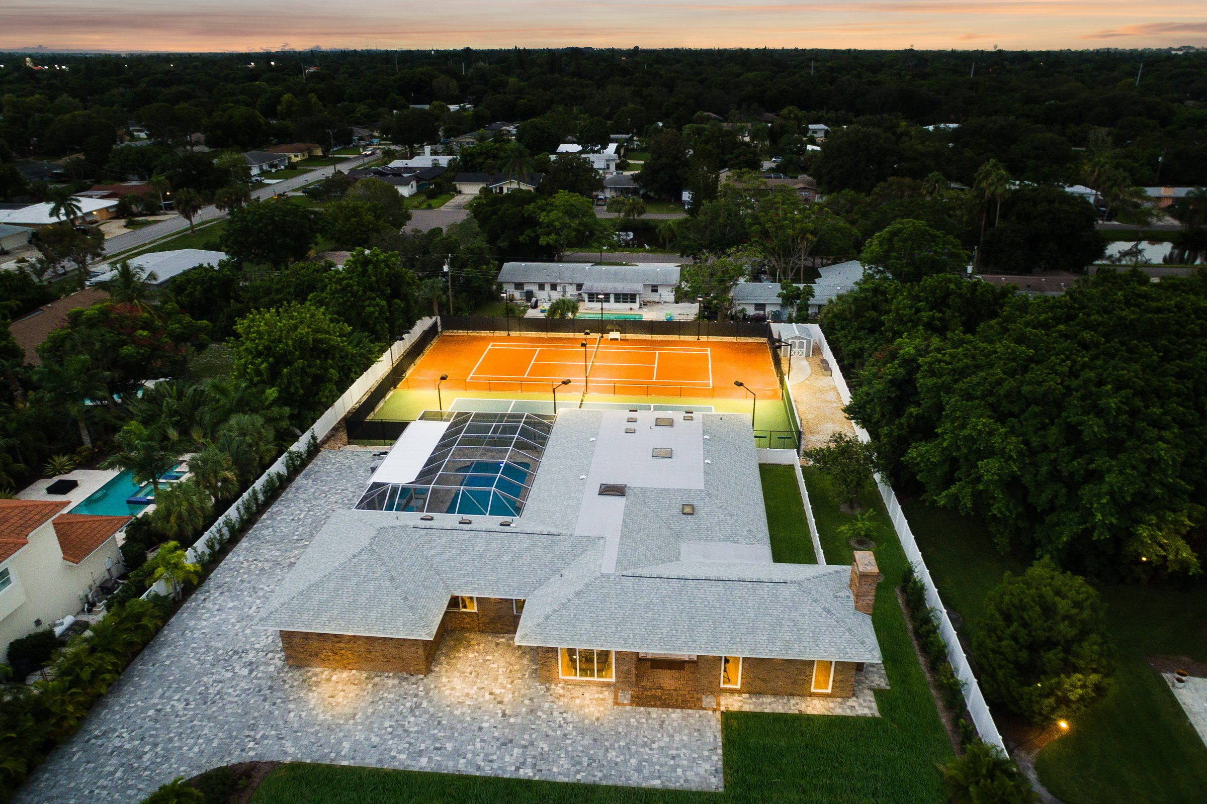 Renovated to perfection in 2014, this one-acre estate combines world-class tennis facilities with contemporary design for eco-savvy living on Florida's Gulf Coast.