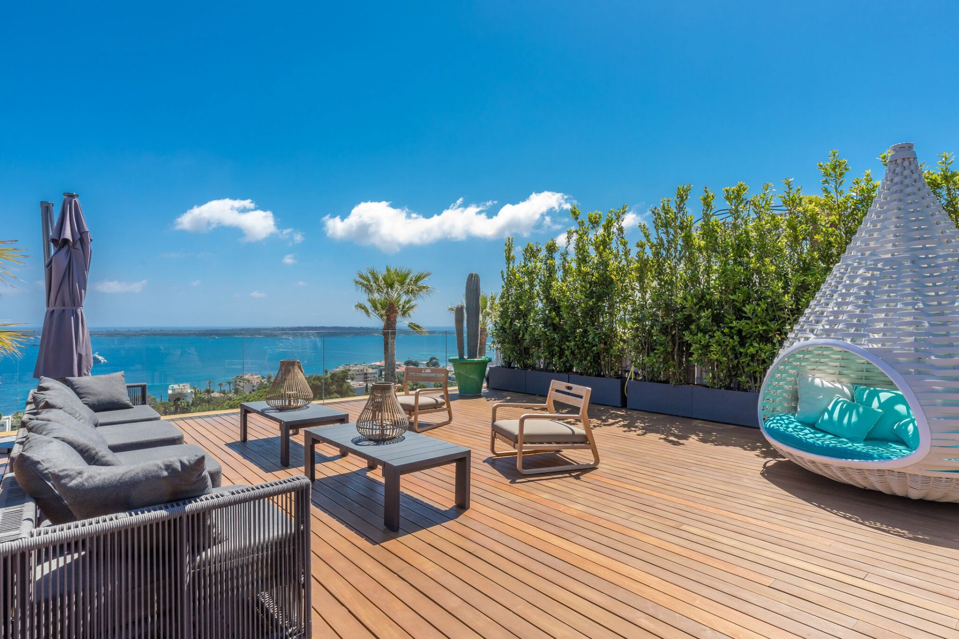 The decks and windows of this Cannes hillside penthouse open up to welcome a vast Côte d'Azur view.