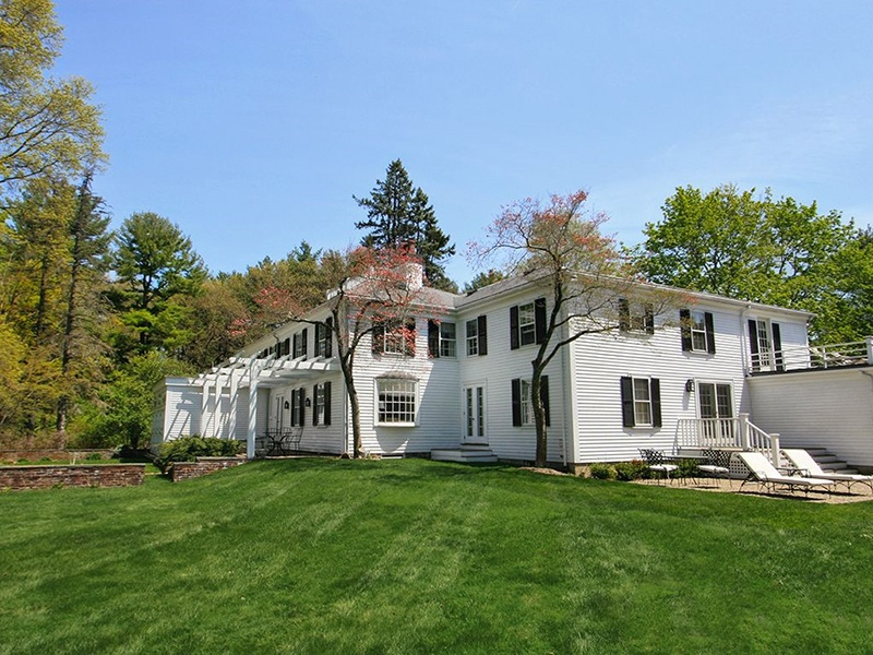 This original 18th-century farmhouse in Hamilton is set on more than 11 private acres and includes five bedrooms, four full baths, and a new chef's kitchen. On the market with LandVest, Inc., an exclusive affiliate of Christie's International Real Estate.
