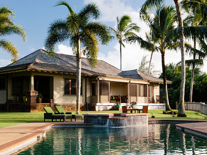 "To achieve ""a fluid integration"" with its surroundings, the home on Kauapea Road draws design elements from traditional craftsman-style houses and tropical plantations."