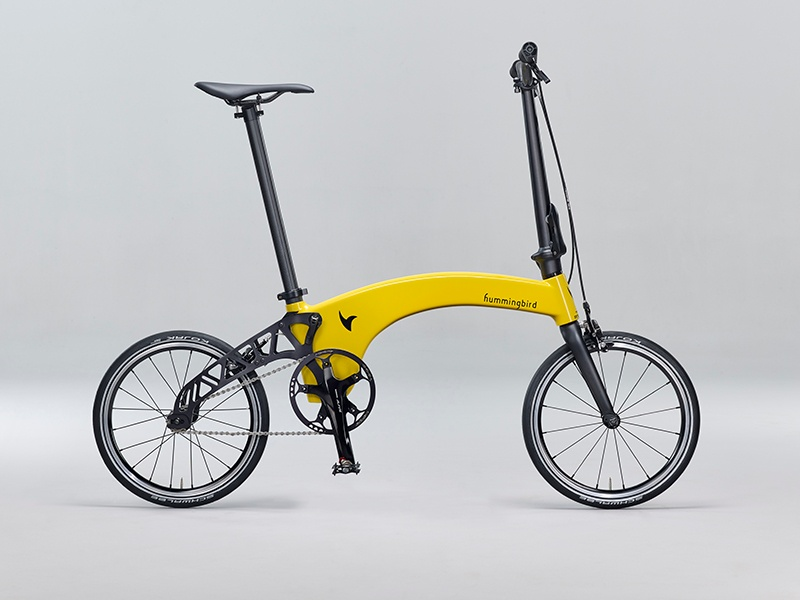 Hummingbird's new carbon-fiber, foldable bike—in Hummingbird Yellow, Prestige Black, Freedom Blue, or Burnt Orange—weighs only 15 pounds and can be folded in three steps.