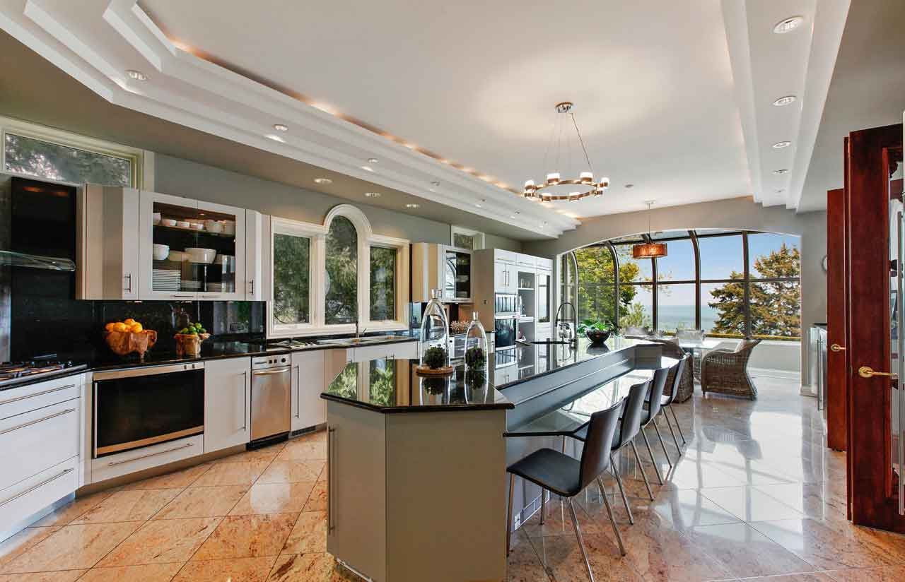 Designed for the epicurean, the kitchen is chock-full of appliances as well as a bar and a separate breakfast nook with a breathtaking panorama of Lake Michigan.