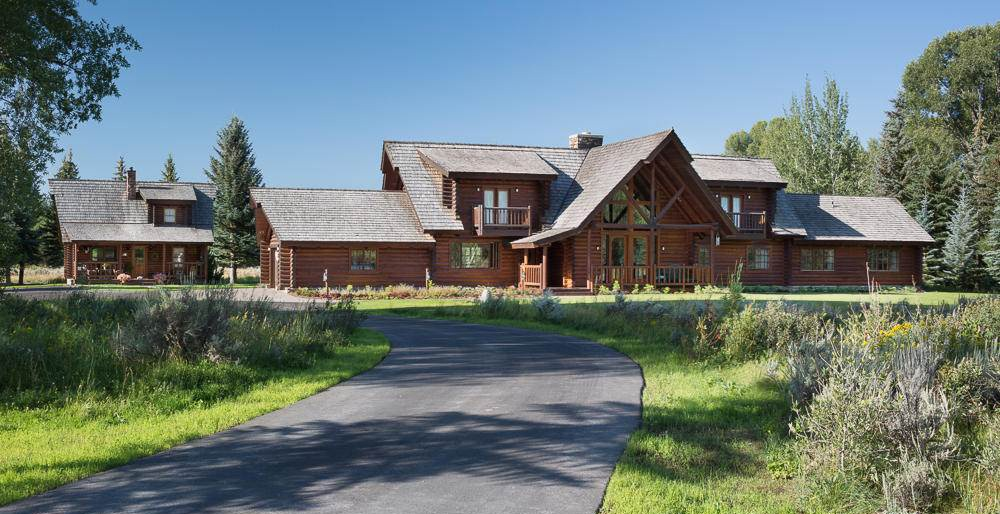 Ideally situated on nearly 13 acres, this 4,240-square-foot, two-story log home is a true mountain retreat. The home's idyllic setting in Wyoming's Wilderness Ranch, near Jackson, captures prominent views of the Grand Teton and Jackson Hole Mountain Resort—a skiing and mountain-biking paradise.
