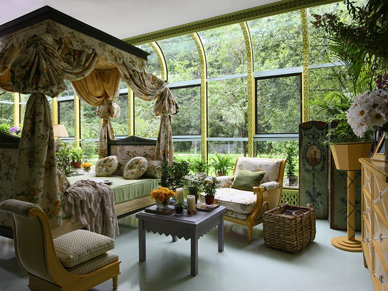 Apple green and golden yellow bring sunshine and foliage into this indoor–outdoor room all year long. Photograph: Kirill Istomin Interior Design