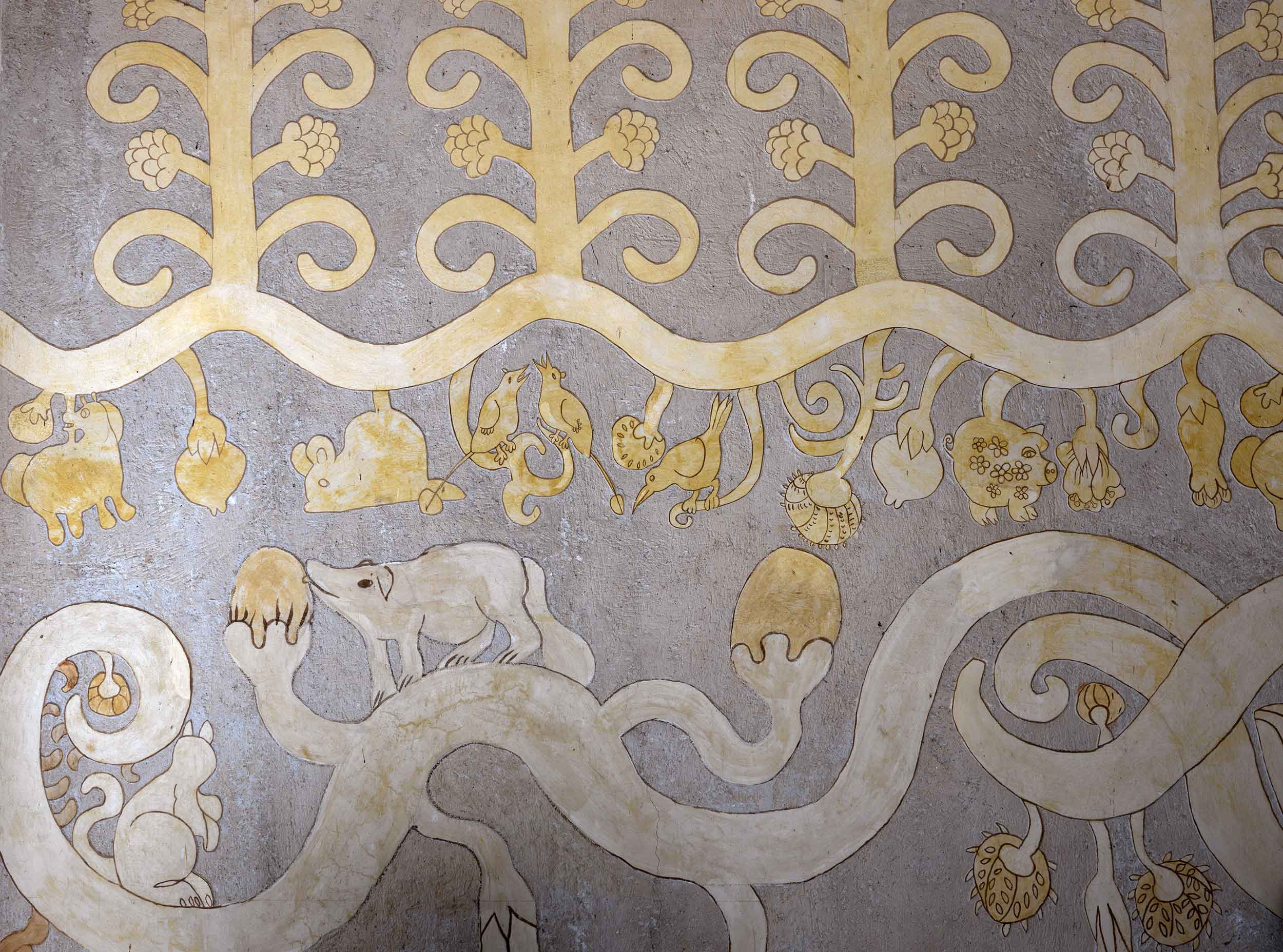 This mural with animal and bird motifs is just one of the estate's many artistic features.