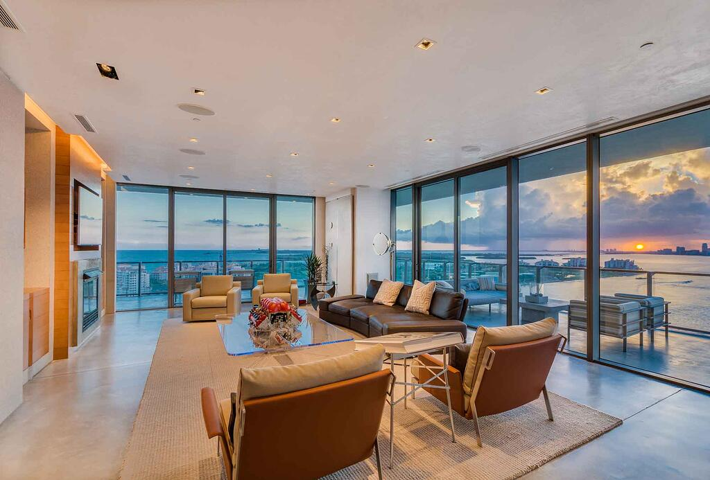 Clean modernist lines and plentiful windows of this perfect penthouse offer more than 200-degree views of South Beach and the Miami coastline.