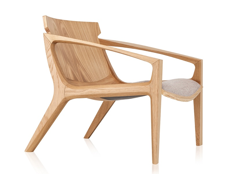 The LINNA is a contemporary, relaxed armchair design by Jader Almeida, fashioned from solid wood with an upholstered seat.