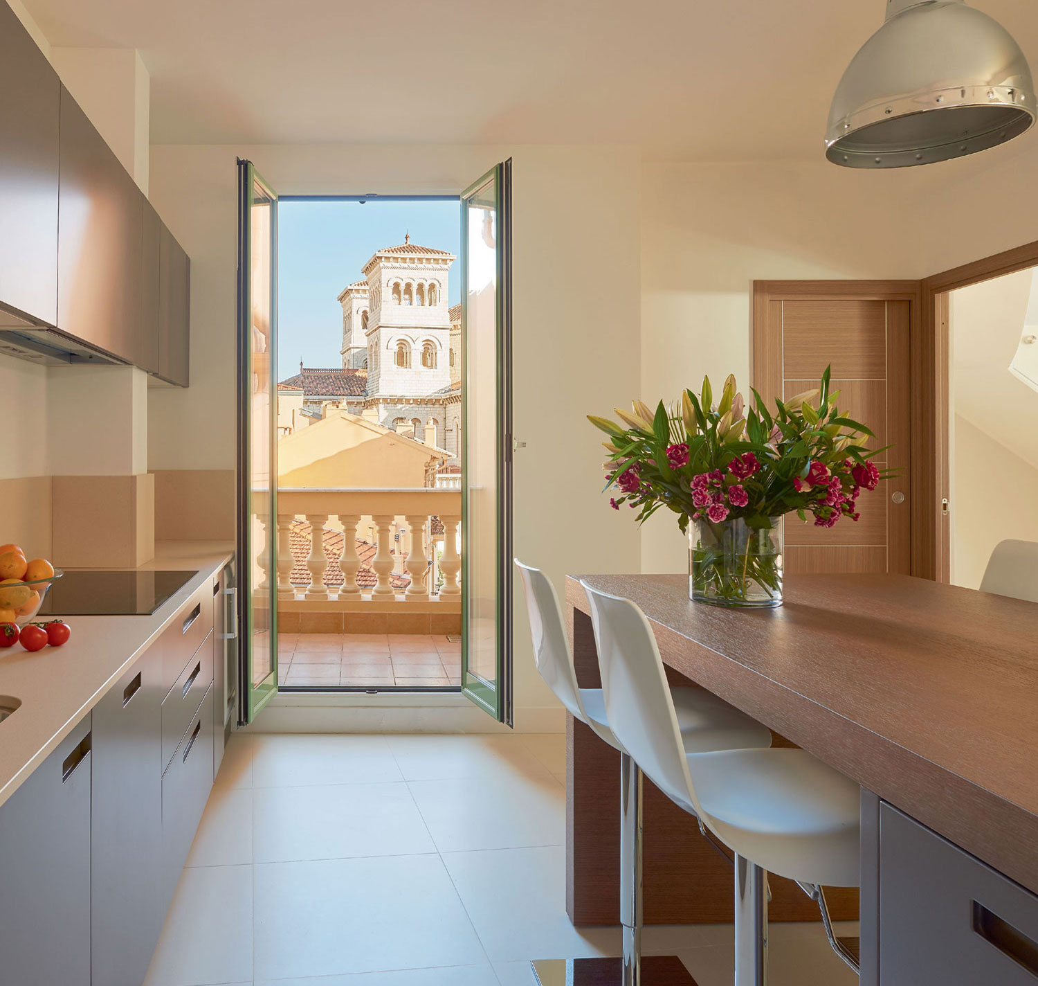 The kitchen level is surrounded by a balcony offering romantic views of the harbor below.