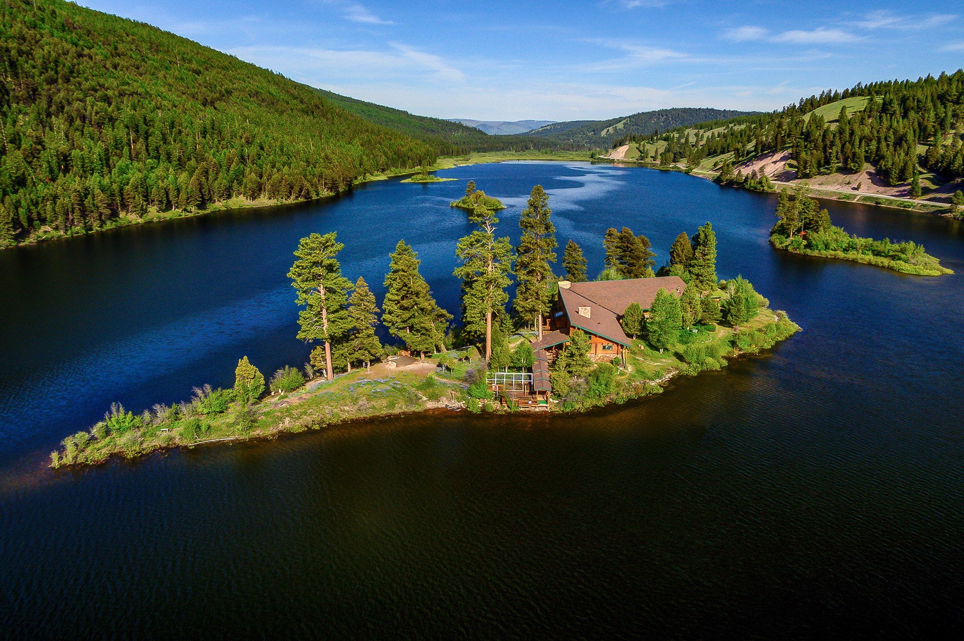 This secluded 30-acre estate in Seeley Lake, Montana, offers private island living in the great American West.