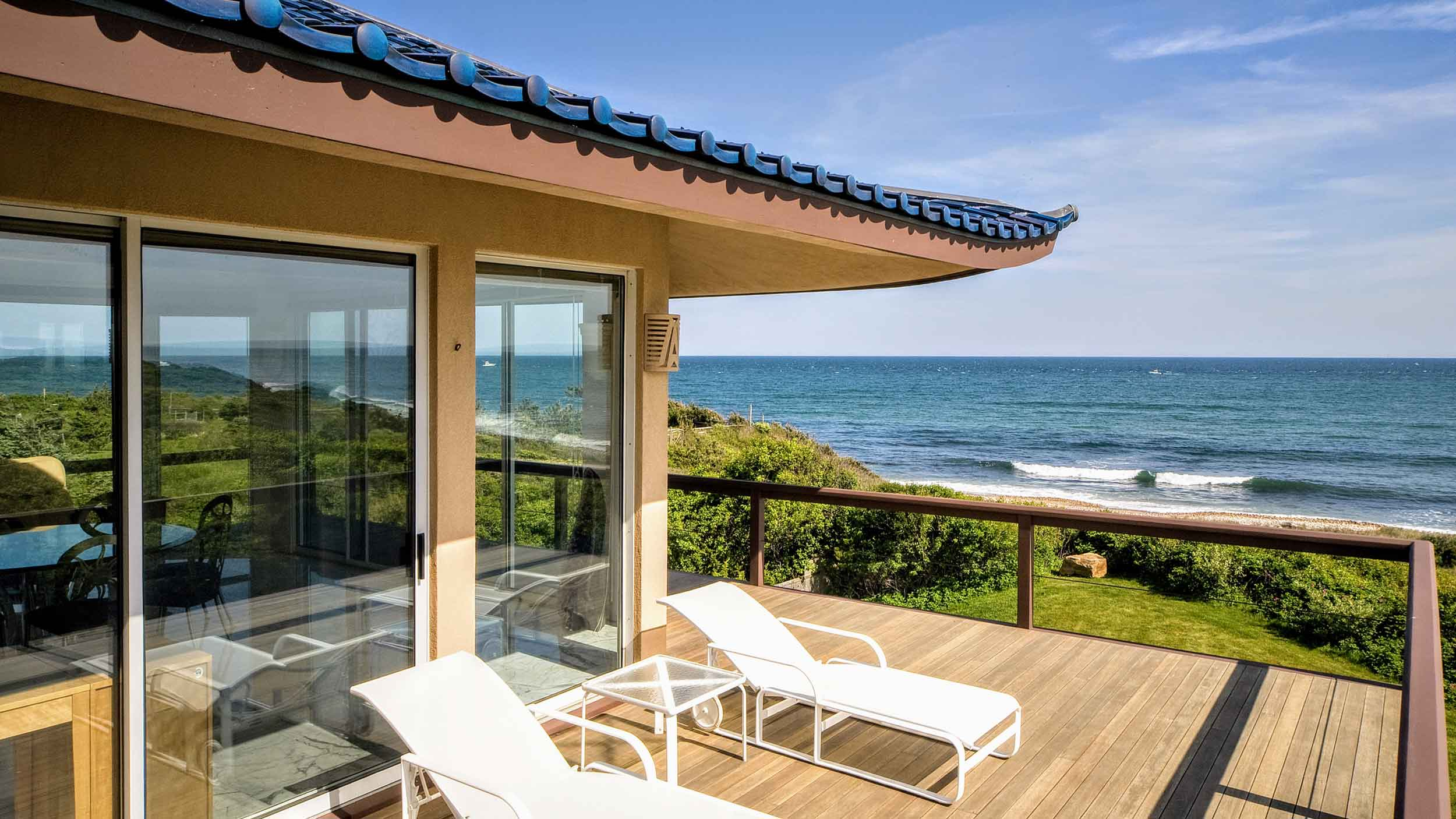 This Zen-inspired Hamptons residence is hidden within a private nature preserve on a bluff overlooking a secluded, sandy beach.