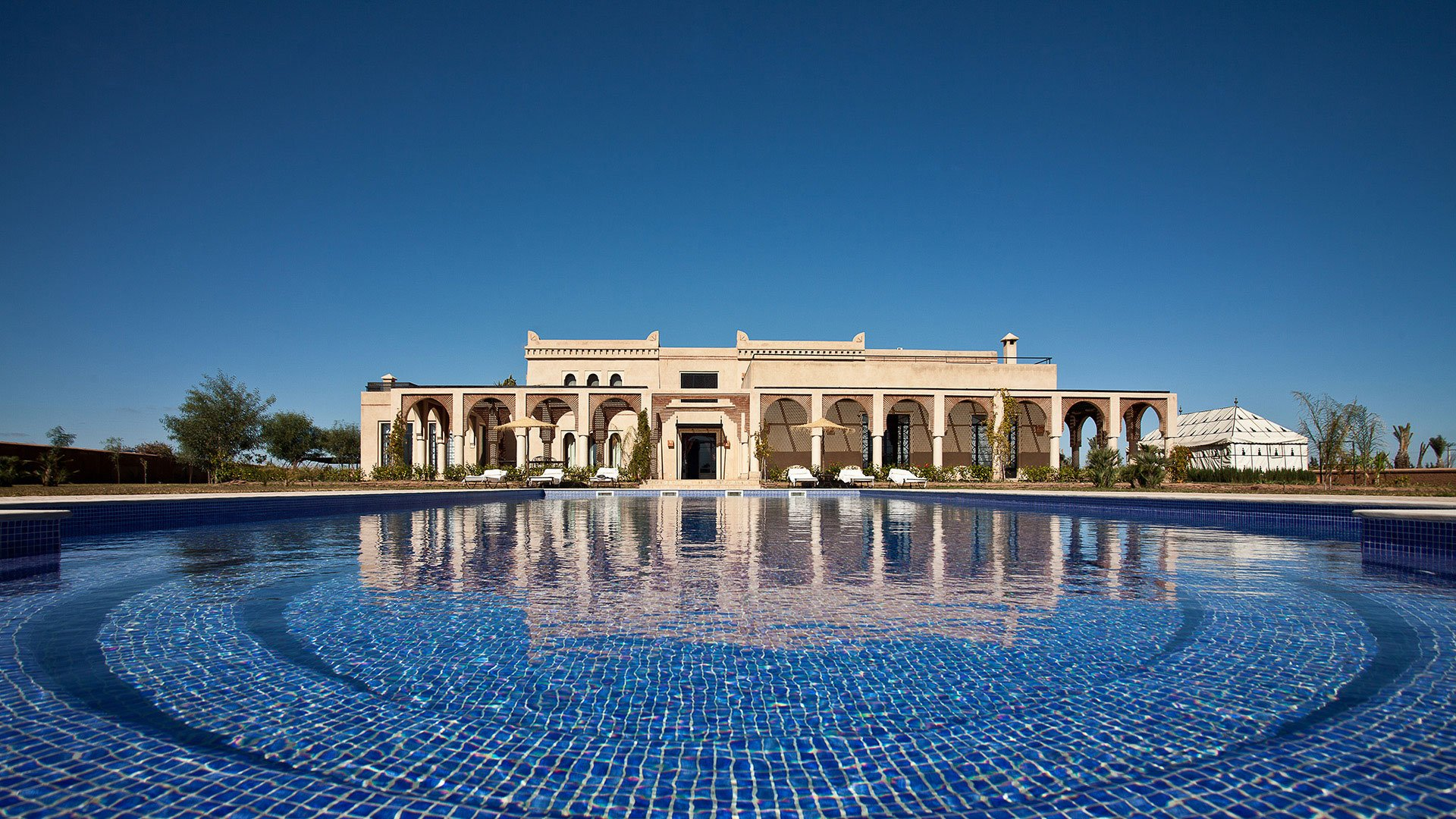 Villa Marrakesh lies just outside the vibrant city of Marrakesh, renowned for its medieval Medina (a UNESCO World Heritage site), labyrinthine passageways, bustling souks, and beautiful riads, made famous by celebrated artists, writers, and cultural figures.