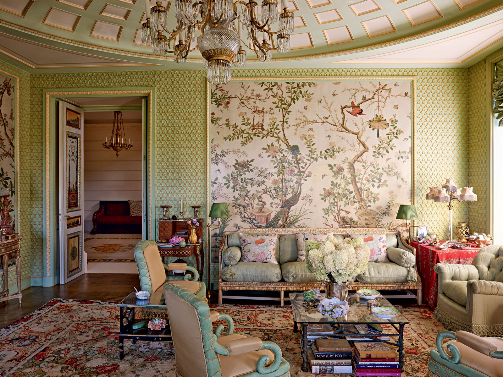 Legendary French decorator Henri Samuel, a favorite in high-society homes, was inspired by a range of styles in his work, as seen in the Winter Garden room, which nods to 18th-century European chinoiserie.