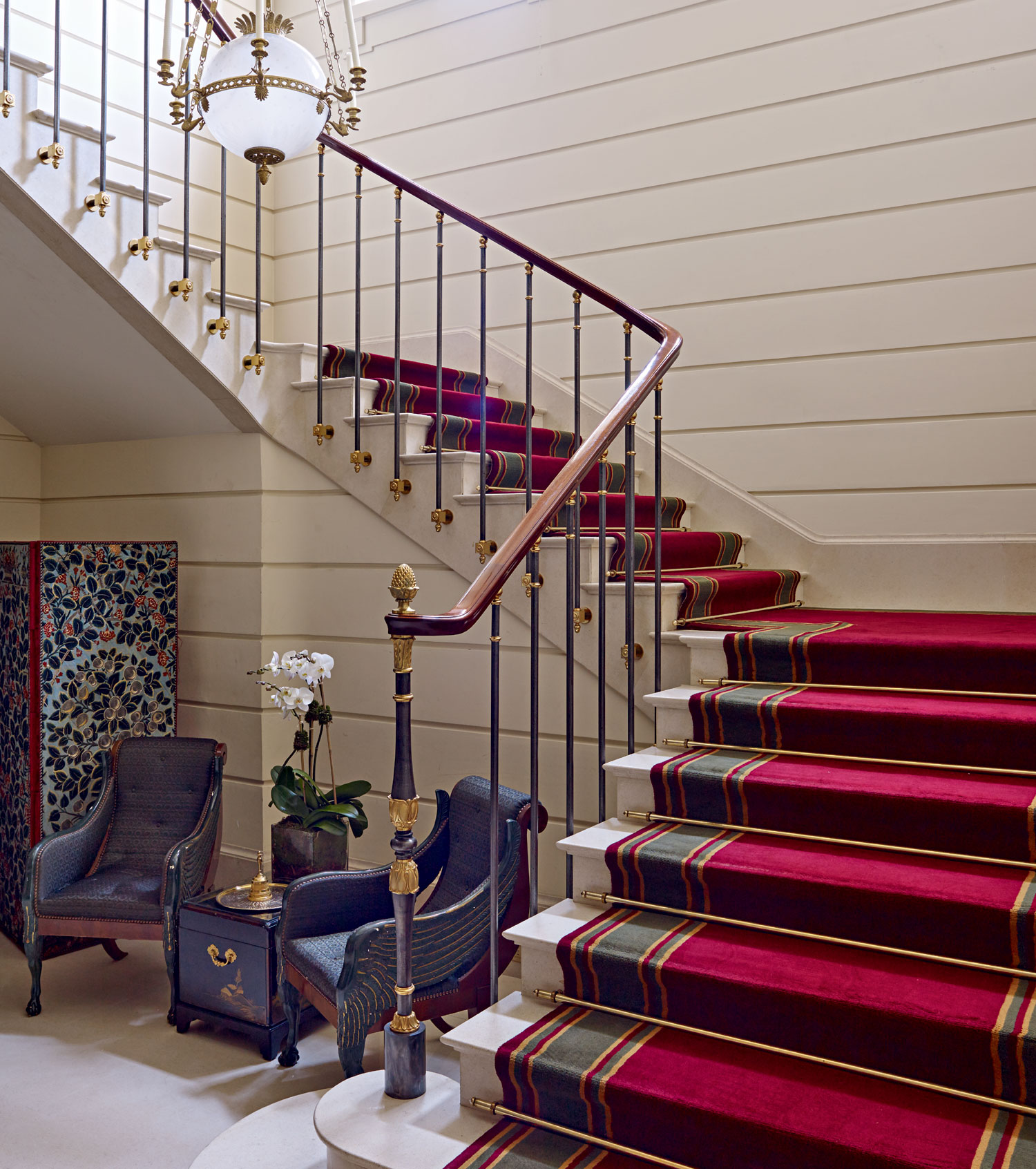 The marble and steel staircase draws inspiration from French châteaux, and was imported to decorate the gallery that leads to the upper floor.