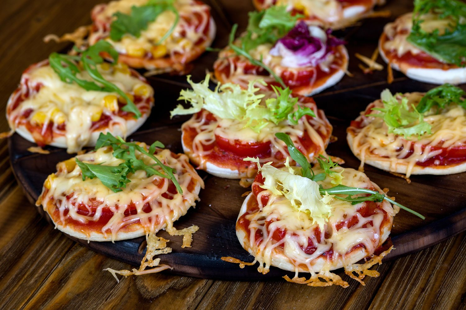 """For a gourmet experience, the Food Network recommends that """"rather than ordering in delivery, offer guests something a bit more impressive with adorable homemade cheese pizzettes."""""""