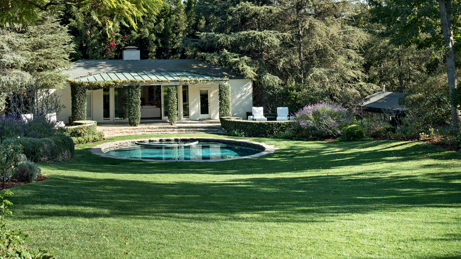 Over four-and-a-half acres of park-like grounds feature rare specimens of Arizona cypress, Brazilian pepper, Brisbane box, evergreen pear, Canary Island and dwarf mugo pine, and weeping cedar of Lebanon.