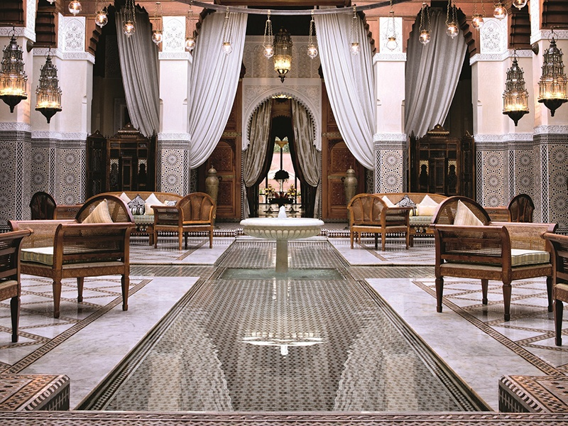 The interior of Royal Mansour pays homage to Morocco's artisan craftsmen, with distinctive geometric zellige tiles covering walls and pillars.