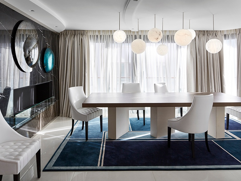 Parisian designer Stéphanie Coutas has mixed clean lines, varied textures, and bursts of color for this dining room in a Cannes penthouse. Photograph: Francis Amiand