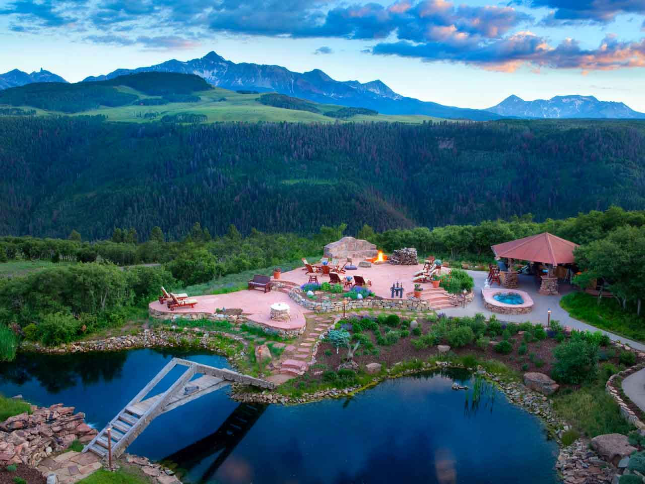 Catmando is a private, 35-acre compound at eye level with the Colorado Rockies. By day or eventide, the estate's fire-lit terrace is a lavish venue to view the majestic Gray Head Wilderness and Rocky Mountains. By night, residents can watch the stars from their own private observatory.