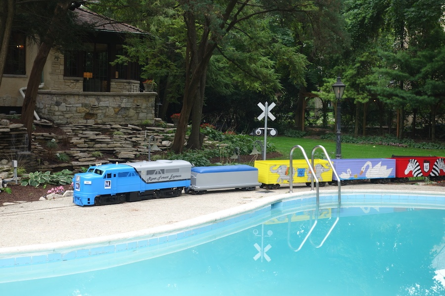 A miniature train traverses the grounds of this Tudor-style estate, adding a pop of color and a welcome touch of whimsey to its elegant grounds.