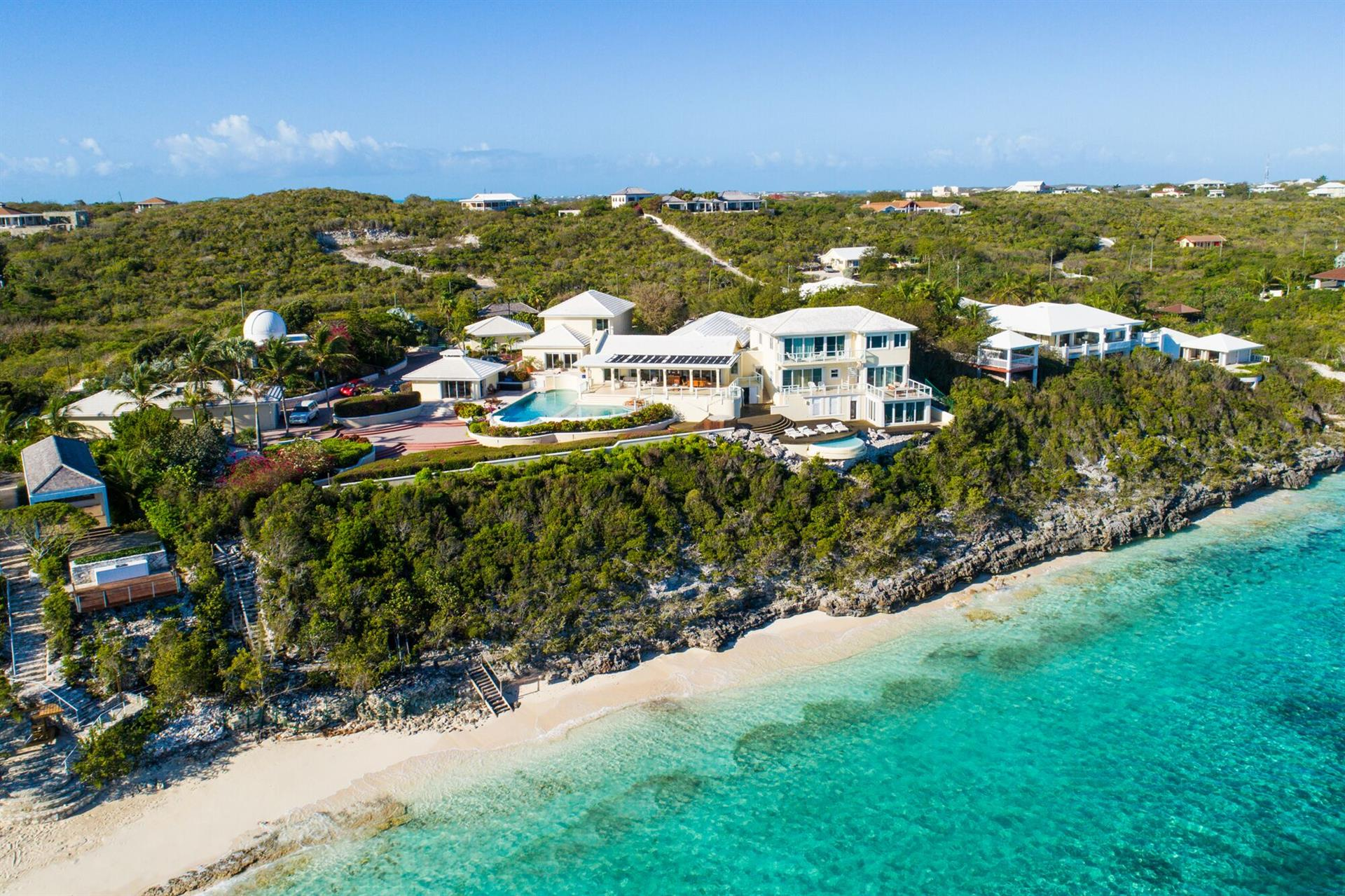 This stunning, skillfully designed property combines light, space, and spectacular ocean views to create an environment like no other, from the white-sand beach to the pond stocked with turtles to the private observatory (the only one on the archipelago).
