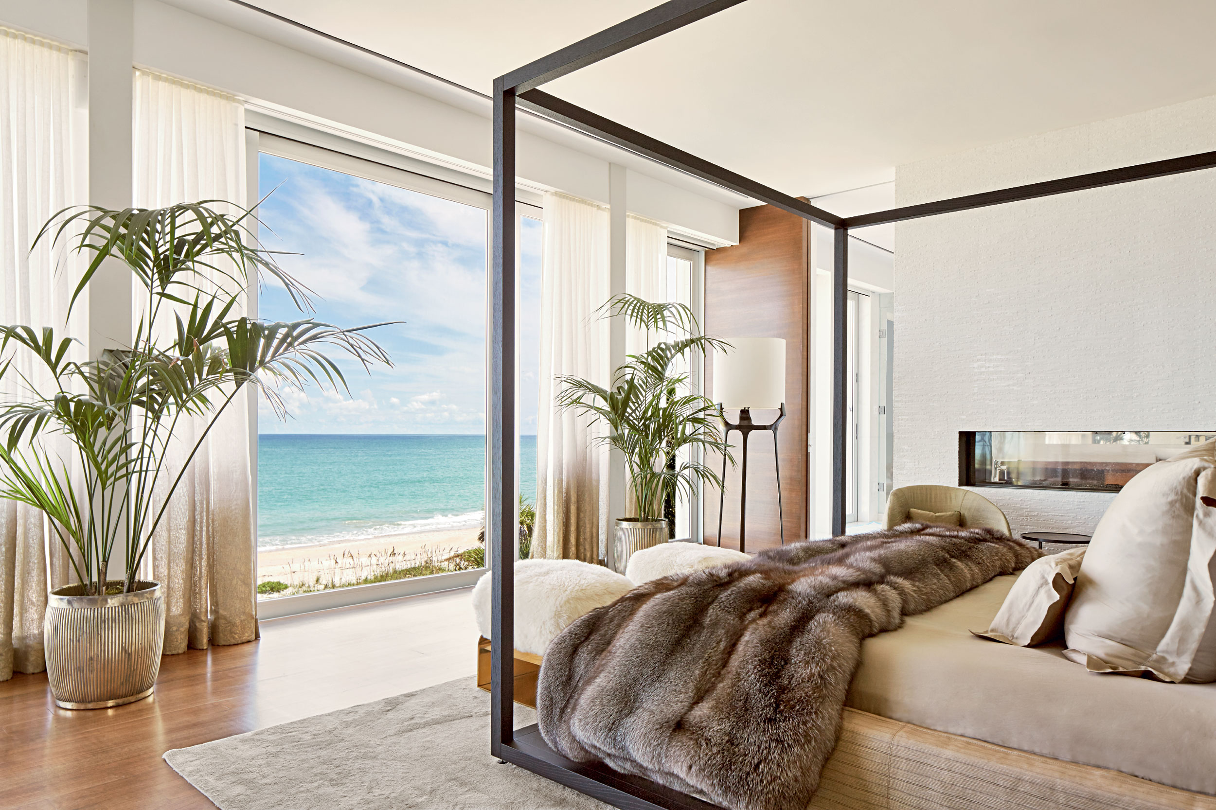 Alongside a lavish master suite and three additional bedroom suites, the estate—set on 1.7 acres with a 200-foot stretch of beach frontage—has a three-bedroom guesthouse, two pools, a beachside tiki hut, and an array of terraces.
