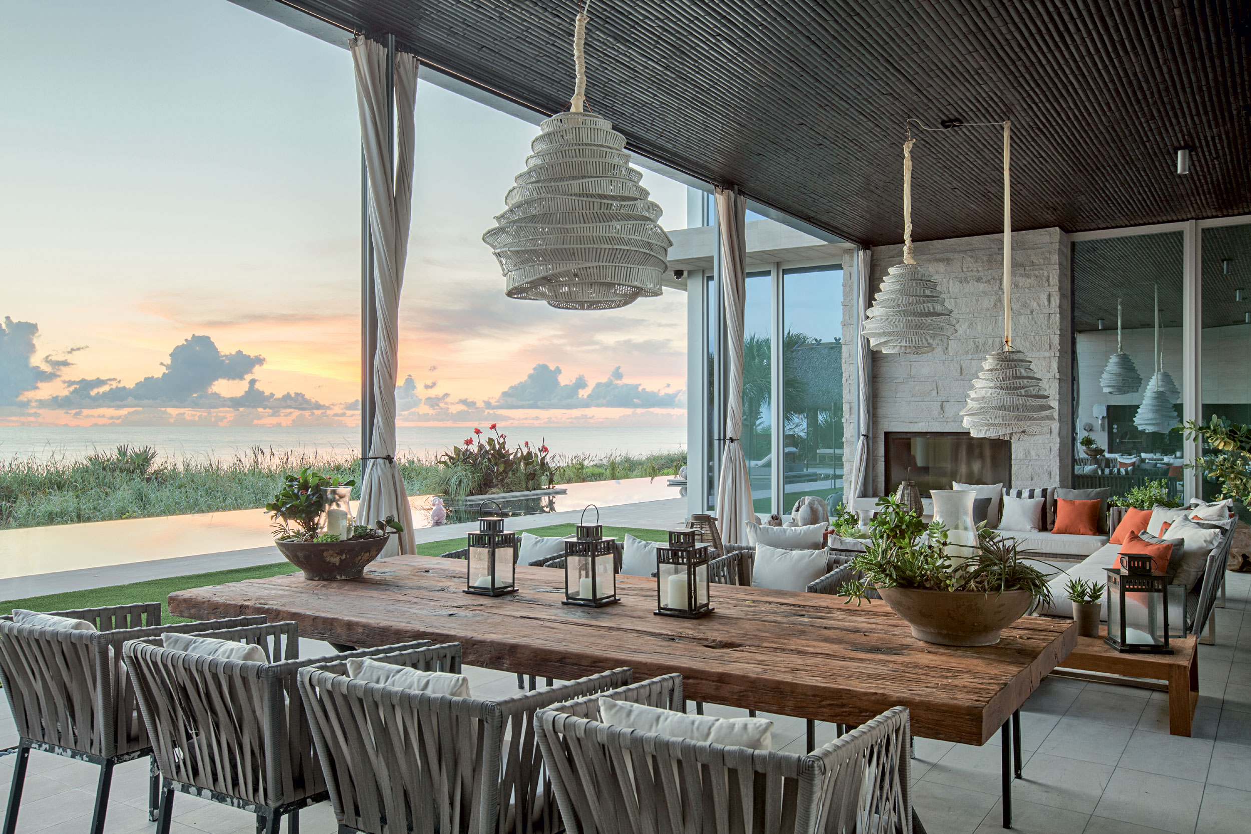 The oceanfront lanai has a fireplace and full summer kitchen with wood-fired pizza oven overlooking an 80-foot-long infinity and wading pool with in-water seating.