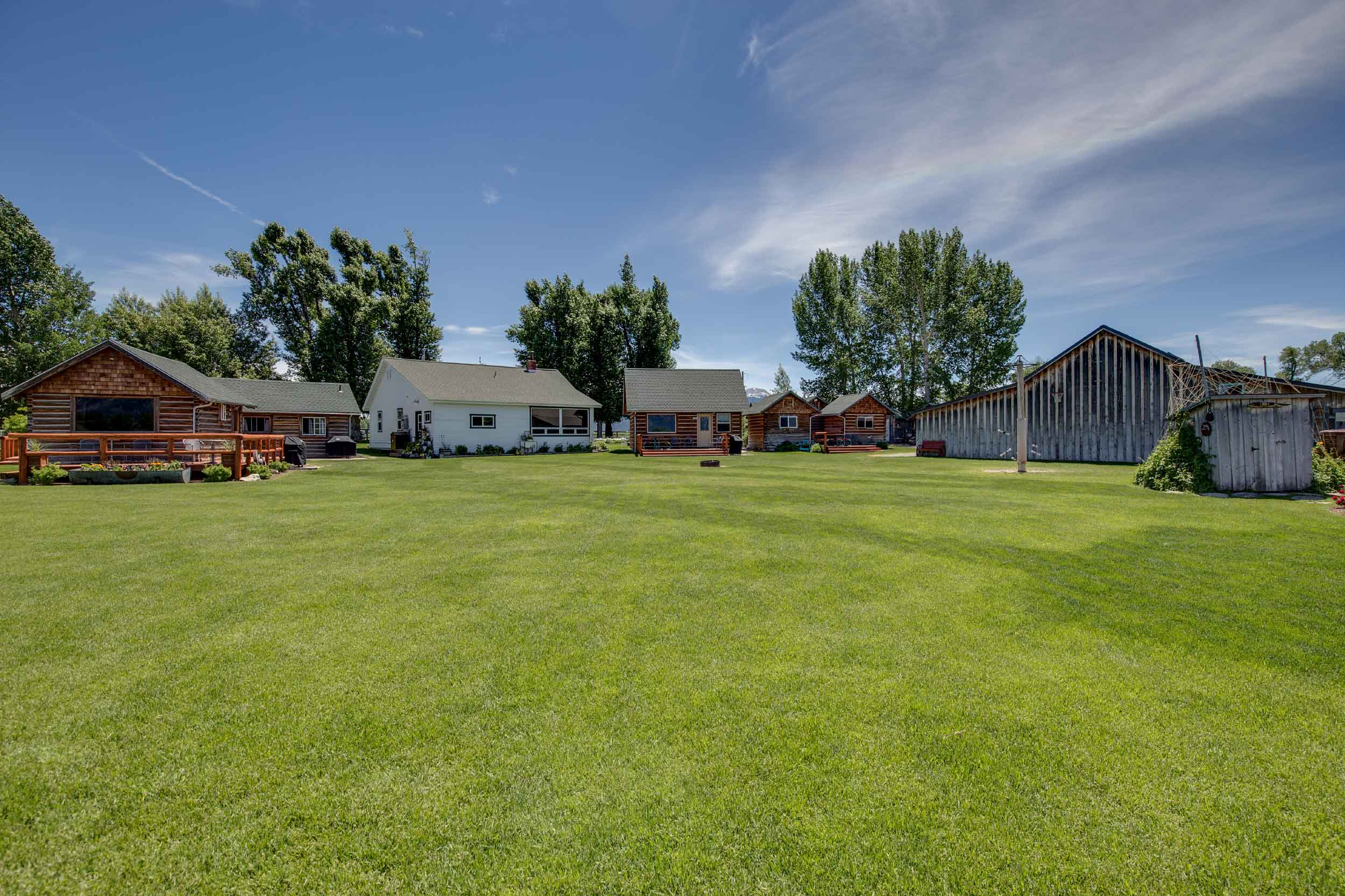 "Grand Teton National Park is quite literally the ""backyard"" of this luxury compound, the last private homestead in the Mormon Row Historic District."